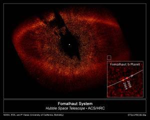Particualas de polvo del sistema Fomalhaut y fotografias de Fomalhaut b